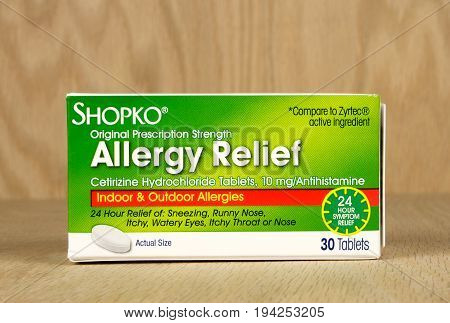 RIVER FALLS,WISCONSIN-JULY 07,2017: A box of Shopko brand allergy relief tablets with a wood background.