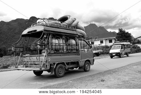 B-w Photo Of Adventure Traveller Car In Laos
