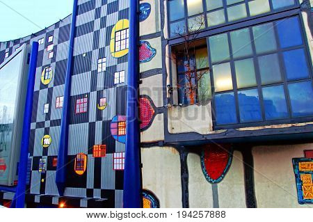 VIENNA, AUSTRIA - DECEMBER 31, 2007: Spittelau waste incineration and district heating plant by Hundertwasse in the evening