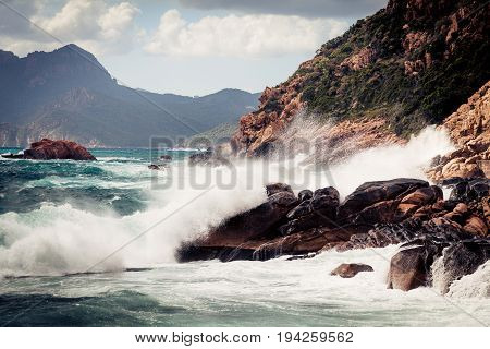 violent waves splashing against corsica's coast just off the city of porto in the island's north-west