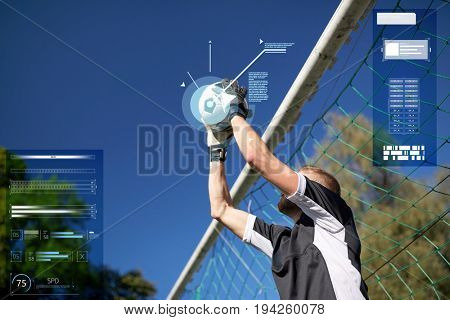 sport, technology and people - soccer player or goalkeeper catching ball at football goal on field