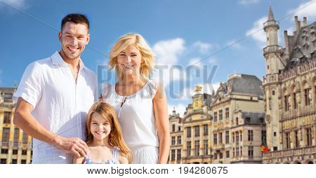 tourism, travel and people concept - happy family over grand place in brussels city background