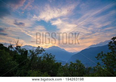 Soft Pastel Colored Sky Over Rocky Mountain Peaks, Ridges And Valleys Of The Alps At Twilight. Torin