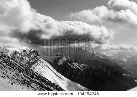 Black and white view of winter mountains in evening and cloudy sky. Caucasus Mountains Georgia region Gudauri.