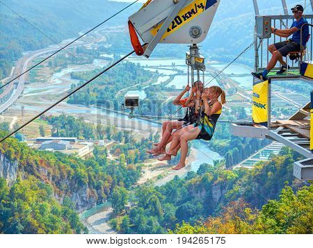 SOCHI, RUSSIA, SEP, 05, 2015: SKYPARK MegaTroll tower start point. Three  people are ready to run RTR. Free fall sliding people tourists for fun. Sochi sightseeing holiday vacation best tours travel