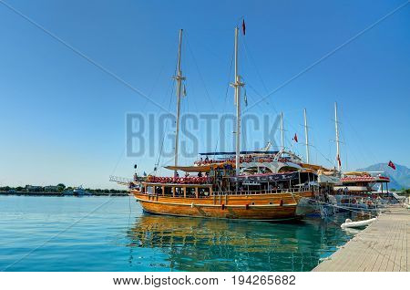 ANTALIA, TURKEY, SEP.10, 2010: View on wooden Pirate corsair style boat ship yacht at pier. Touristic sightseeing pirate boats to visit famous waterfall. Turkey holidays vacations MSC tours cruises