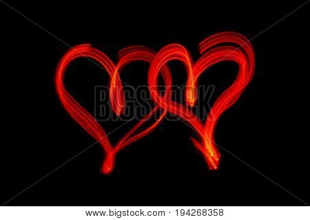 couple of red hearts on black background
