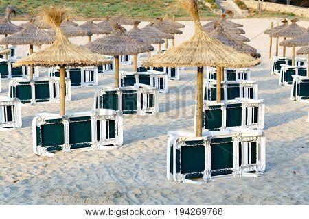 Beach sunbeds and beach umbrellas on the sandy beach