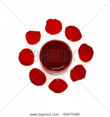 Red Cup Of African Rooibos Red Tea With Rose Petals On White Background, Top View