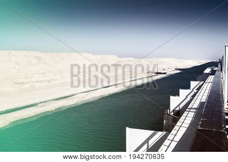 Cruise ship in the newly opened expansion section of the Suez Canal subtle infrared coloring