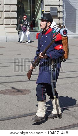 ZURICH - AUGUST 1: Swiss National Day parade on August 1, 2016 in Zurich, Switzerland. Unidentified man in historical costume marching on the Bahnhofstrasse in Zurich