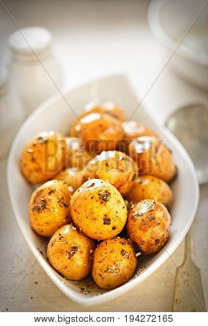 Baby jacket potatoes with herb and garlic oil dressing
