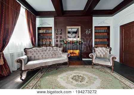 Luxury interior of home library. Sitting room with elegant furniture. shelves with books