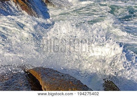 Wave crashing on the rockst of Arpoador beach at Ipanema Rio de Janeiro