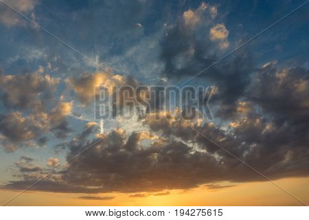 View on a colorful Cloud Formation. Beautiful Skies. Close-up of Big Glowing Skies at Sunset Fresh Air. Twilight. Evening Skies