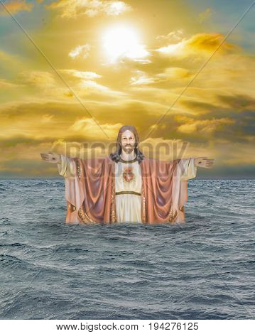 Religious chrisitan background artwork with jesuschrist emerging from the waters against sunset sky background