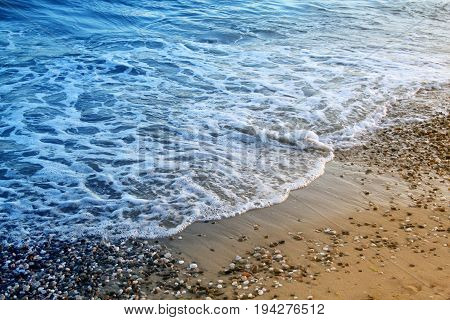 Photo of a beautiful blue wave and sandbag pebbles