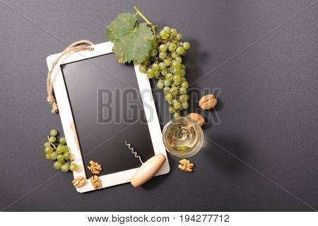 blackboard with grape and wineglass