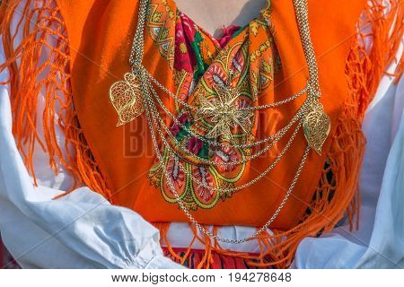 Detail of Portuguese folk costume for woman with multicolored embroidery.