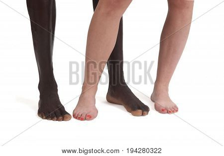 Feet And Legs Of An Interracial Couple On White
