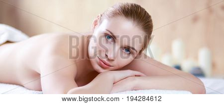 Young woman getting spa massage, lying on spa salon