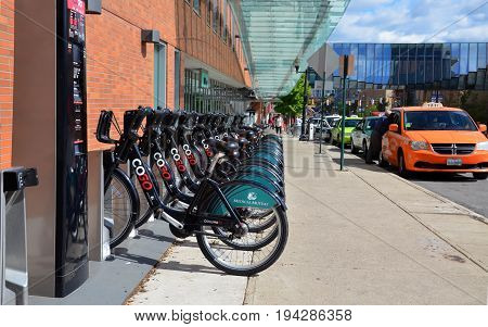 COLUMBUS OH - JUN 27: A CoGo bicycle rental station near the Convention Center in Columbus OH is shown on June 27 2017. The system comprises 41 stations and 365 bikes.
