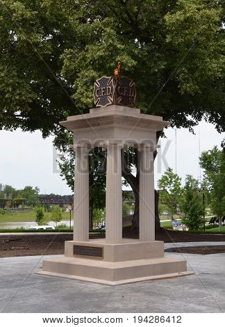 COLUMBUS OH - JUNE 28: The Fire Department Memorial in Battelle Riverfront Park in Columbus Ohio is shown on June 28 2017. An eternal flame sits atop the memorial.