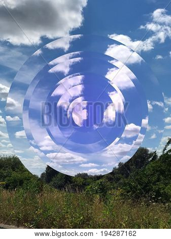 Landscape with green shrubs and trees and a blue cloudy sky with geometric fragmented circles and space for text.