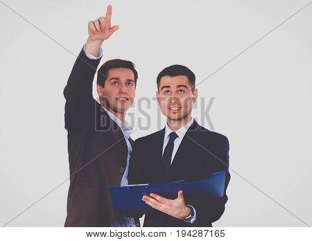 Two business men holding contract folder isolated on white background.