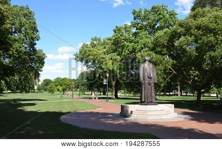 COLUMBUS OH - JUNE 25: A statue of past president William Oxley Thompson overlooks the Oval at Ohio State University in Columbus Ohio on June 25 2017.