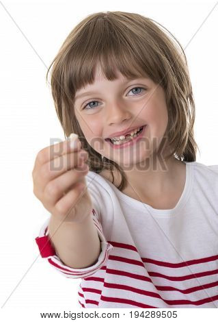 happy little girl pointing her missing teeth in her hand