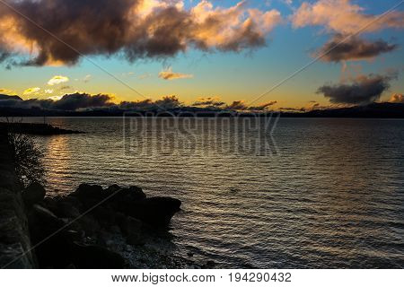 Beautiful sunset at lake nahuel huapi in the city of bariloche in patagonia argentina