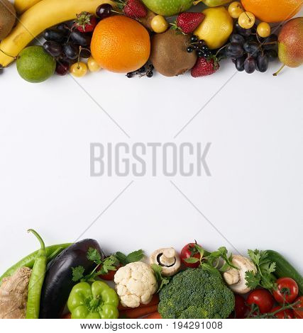 Top view of a huge group of fresh vegetables and fruit on white background with copy space. Vegetables VS Fruit - High quality studio shot
