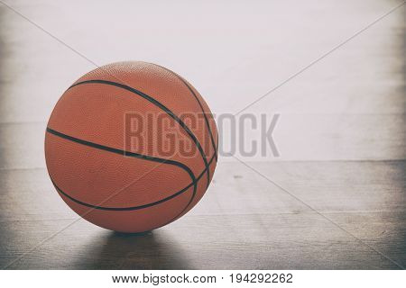 Basketball on a wooden court floor