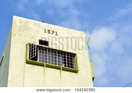 The number 1971 tells when the historical building was built with a nice beautiful blue sky in the background.