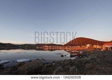 Sunset over the community of  Qikiqtarjuaq, Broughton Island, Nunavut, Canada