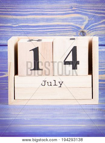 July 14Th. Date Of 14 July On Wooden Cube Calendar