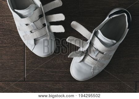Pair of white shoes on velcro top view close-up