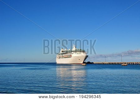 Cruise ship docked on a beautiful blue ocean