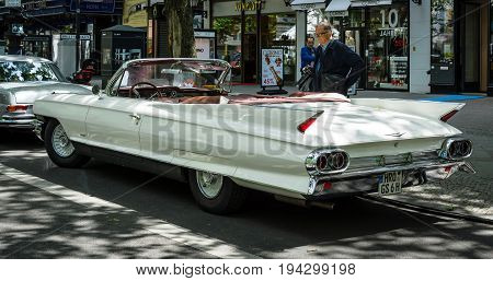 BERLIN - JUNE 17 2017: Full-size luxury car Cadillac Series 62 Convertible Coupe 1961. Rear view. Classic Days Berlin 2017.