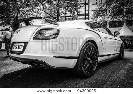 BERLIN - JUNE 17 2017: Personal luxury car Bentley Continental GT 2017. Rear view. Black and white. Classic Days Berlin 2017.