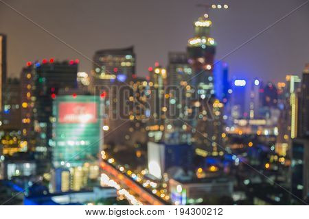 Blurred bokeh light central business downtown city night view abstract background