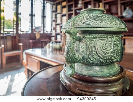 Suzhou, China - Nov 5, 2016: Master of Nets Garden (Wang Shi Yuan); classical Chinese study and calligraphy room featuring an old  bronze incense burner.