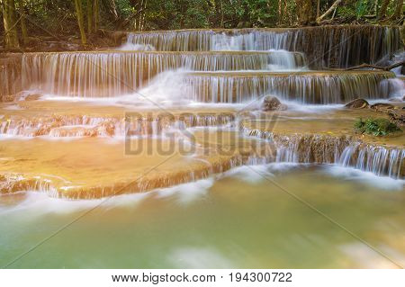 Natural multiple layers stream waterfall in tropical national park of Thailand natural landscape background