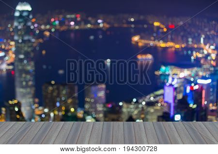 Night blurred bokeh light city of Hong Kong over Victoria bay abstract background