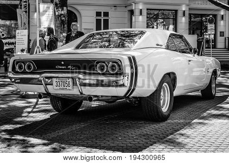 BERLIN - JUNE 17 2017: Mid-size car Dodge Charger R/T 1968. Rear view. Black and white. Classic Days Berlin 2017.