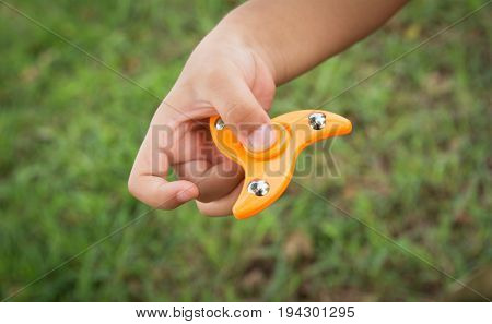 Children play with finger spinner gadget. Popular spinner device to play balance game.