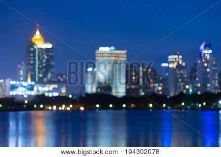 Blue twilight with city blurred bokeh light water front abstract background