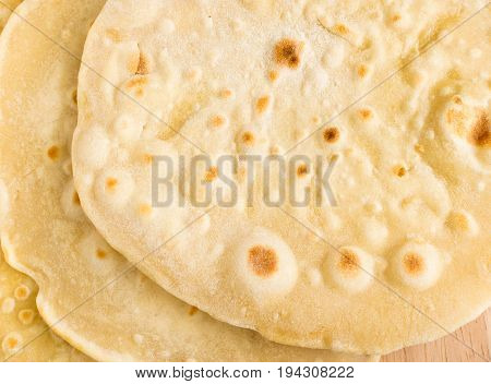 Flat Bread On A Wooden Background