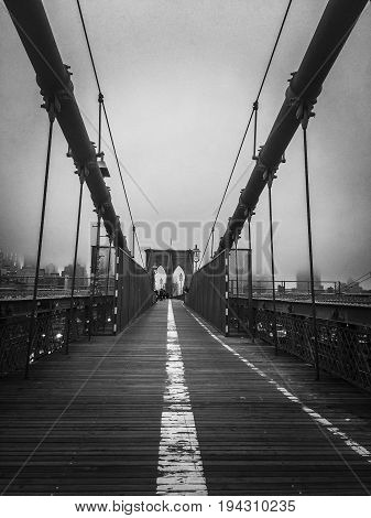 Walkway at Brooklyn bridge with foggy in black and white style